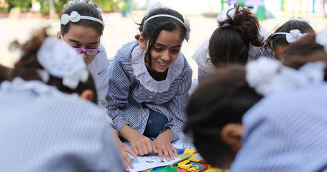 A Palestine child refugees drawing during a Community Mental Health Programme (CMHP) activity at Al-Amal Preparatory Girls in Khan Younis, southern Gaza . Photo credit: ©UNRWA Gaza 2017. Photo by Rushdi Al-Sarraj.