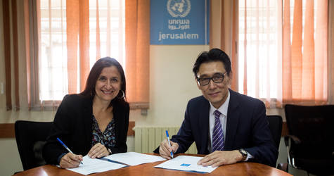 Young-sam Choi, the Head of the Representative Office of the Republic of Korea in Palestine, and Francoise Vanni, the Director of External Relations and Communications at UNRWA, sign an agreement on 11 May 2017 outlining the Republic of Korea's US$ 450,000 contribution to UNRWA to develop and promote safe spaces and healthy lifestyles for Palestine refugee children in Gaza. © 2017 UNRWA Photo by Marwan Baghdadi