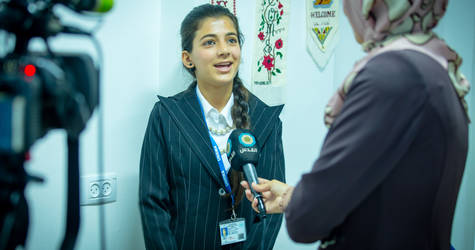Reem Yaghy speaks with a journalist from Al Quds Network. © 2017 UNRWA  Photo by Yahia Masswadeh