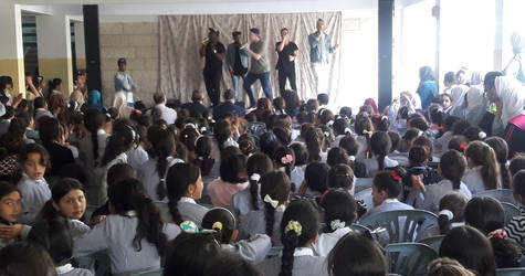 The Exchange perform to a full audience at the Qattaneh Girls School in the West Bank. Their tour was organized as part of an annual United States Department of State's Bureau of Educational and Cultural Affairs' American Music Abroad programme. © 2017 UNRWA  Photo by Riham Jafary