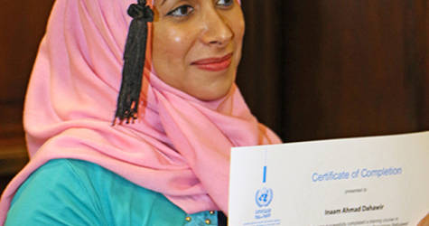 An UNRWA staff member who underwent training in psychosocial support through funds from the German government receives her certificate. © 2017 UNRWA Photo by Mahmoud Abu Salah