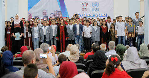 Graduates of the SFWs Student Ambassador Programme sing the national anthem during their graduation ceremony. © 2017 UNRWA Photo by Tamer Hamam