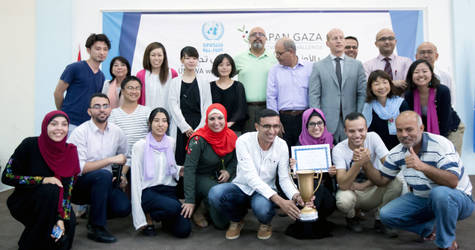 The winning team of 2017 Gaza Entrepreneur Challenge accompanied by the Deputy Director of UNRWA Operations in Gaza, David de Bold; the Director of the UNRWA health programme, Dr. Akihiro Seita; senior UNRWA staff and Gaza Entrepreneur Challenge judges; and organizers. © 2017 UNRWA Photo by Tamer Hamam