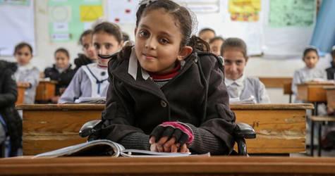 Zena Z Ghalban (10) takes a seat among her classmates at the UNRWA Maen Elementary Girls School in Khan Yunis.  © 2018 UNRWA Photo by Khalil Adwan