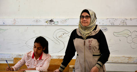 Nuha Abu Nasser with one of her students at a recently re-opened UNRWA school in Sbeineh camp, Rif Damascus, Syria ©2018 UNRWA Photo by Fernande van Tets