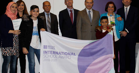 UNRWA students stand with their school principals and Mr. Salem Dib, Chief of UNRWA education programme to receive an International School Award (ISA), in presence of Mr. David Knox, Country Director of the British Council in Lebanon. © 2018 UNRWA Photo by Cécile Massin