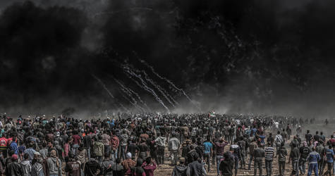 Palestinian demonstrators gather in Khuza'a on the Gaza side of the perimeter fence between Israel and the Gaza Strip during the Great March of Return demonstration on 6 April 2018. © 2018 Photo Courtesy of Mahmoud Bassam
