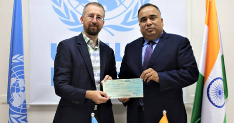 Mr. Marc Lassouaoui, UNRWA Chief of Donor Relations receives a generous contribution from H.E. the Representative of the Government of India to the State of Palestine Mr. Sunil Kumar.  © 2019 UNRWA Photo by Marwan Baghdadi