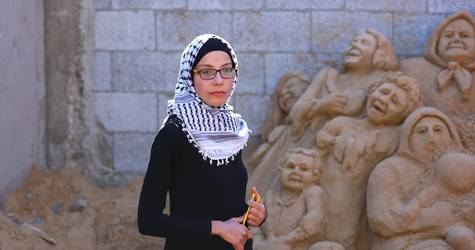 Ranna Al Rimlawi 24 years-old passionately works on one of her sand sculptores at her home in Gaza City, Gaza. © 2019 UNRWA Photo by Ibrahim Abu Usheeba