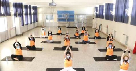 Female sta observe physical distancing while participating in a yoga session in Damascus © 2020 UNRWA Photo