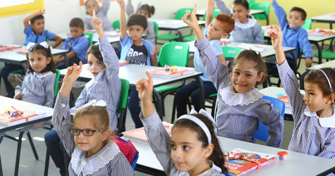 First grade students from UNRWA Sabra Elementary Co-ed School receiving their new stationery on the first day of school. © 2019 UNRWA. Photo by Khalil Adwan