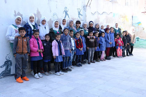"Student participants of the ""Little Teachers Initiative"" photographed with their mentees at the UNRWA Jabal El-Hussien School in Jordan © 2019 UNRWA  photo by Daniah Al Batayneh"