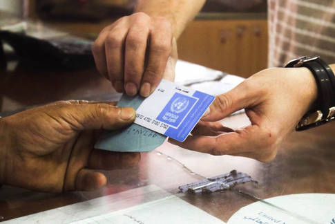 Evaluation of the UNRWA transition to the e-card (cash) modality