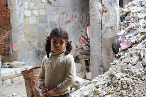 A young girl stands in the rubble of Qabr Essit, near Damascus. In 2014, UNRWA was able begin rebuilding facilities within the neighbourhood, including a school and community centre © 2014 UNRWA Photo by Taghrid Mohammad