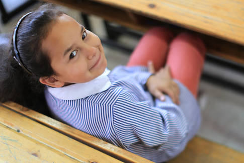 A schoolgirl in an UNRWA school in Am'ari camp, West Bank. © 2013 UNRWA Photo by Alaa Ghohseh