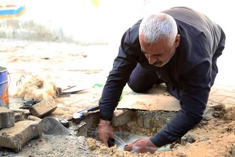 إصلاح شبكة المياه في مخيم جباليا، شمال غزة 2015 © ، الأونروا، تصوير خليل عدوان