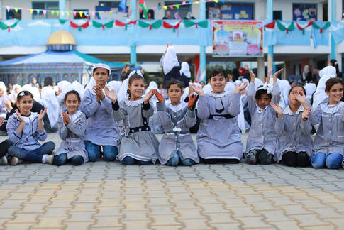 Students from Al-Amal Preparatory School for Girls in Khan Younis, southern Gaza, participate in psychosocial support activities. © 2016 UNRWA Photo by Rushdi Al-Sarraj