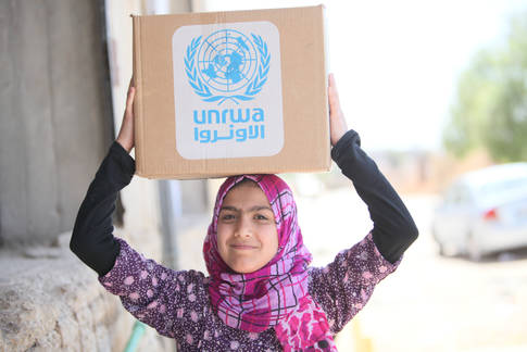 Food distribution at the Sahnaya Distribution Centre, Damascus, Syria. © 2016 UNRWA Photo by Taghrid Mohammad
