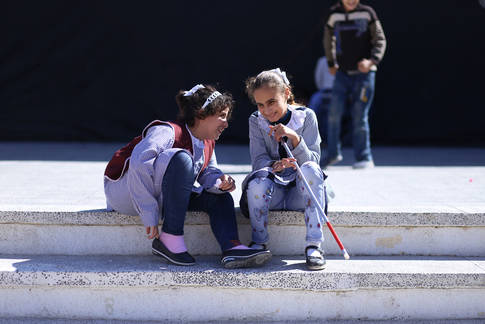 During their recess, two students gather to chat at the UNRWA Rehabilitation Centre for the Visually Impaired. © 2017 UNRWA photo by Rushdi Al Sarraj