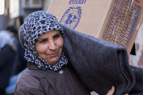 Distribution of food assistance and NFI (non-food items) at al-Thyabiyeh, Rif Damascus, Syria. © 2018 UNRWA Photo by Baraa al-Alem.