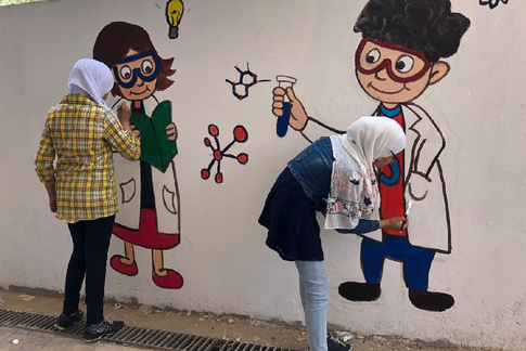 Refugee Girls at SFO Painting a Mural © 2019 UNRWA Photo by Anita Thamm