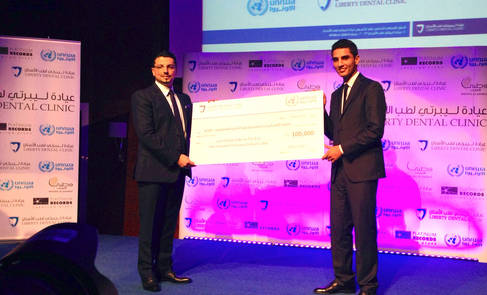Singer Mohammad Assaf receives donation on behalf of UNRWA