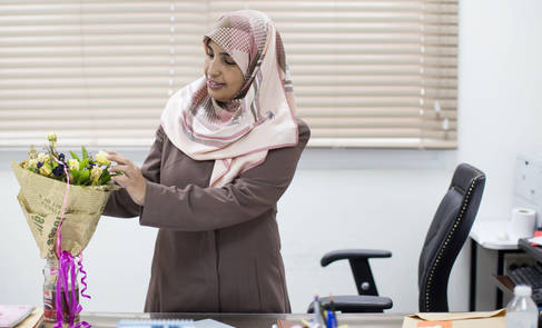 Wafa Diyab, UNRWA Recruitment Officer, received flowers from her colleagues celebrating her UNRWA Gender Equality Champion Award. © 2017 UNRWA Photo by Tamer Hamam
