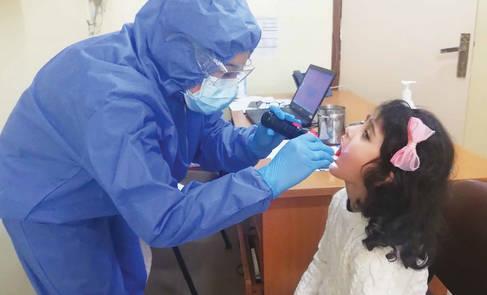 A dentist checking teeth of a girl at a health centre in Syria. © 2020 UNRWA Photo by Ibrahim Miari