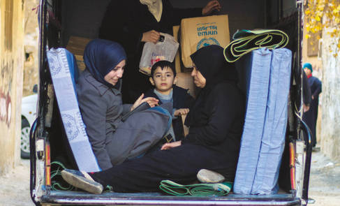 Afamily in Syria collecting non-food items from UNRWA, January 2018. © UNRWA Photo by Baraa al-Alem.