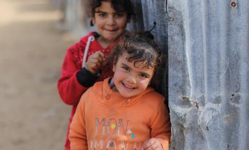 Palestine refugee children playing on the street in a slum in the northern Gaza Strip. © 2017 UNRWA Photo by Rushdi Al-Sarraj.