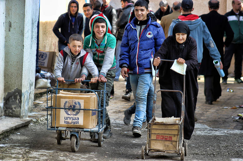 Food distribution funded by ERF supports some of the most vulnerable Palestine refugees across Syria. Sustained humanitarian assistance provides an essential lifeline to families who have no other form of support. February 2015. © 2015 UNRWA Photo by Ahmed Abu Zeid
