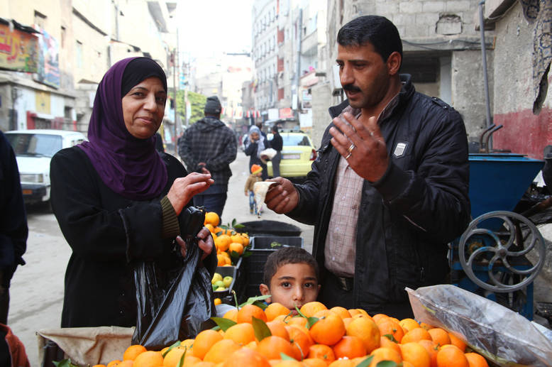 Diminishing savings and rising food prices for basic products such as oil, tomato paste, canned food, flour and olive oil rendered many Palestine refugees food insecure and dependent on UNRWA assistance. Qabr Essit, Syria © 2014 UNRWA Photo by Taghrid Mohammad