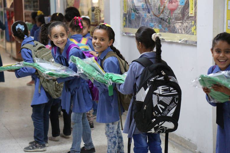 The Chalhoub Group of Saudi Arabia donated 2,500 school bags and kit to Palestine refugees' school students from grades 1 to 3 in Jerash camp and to children attending the camp's Community-Based Rehabilitation Centre (CBRC). © 2016 UNRWA Photo by Ahmad Abu Haweleh
