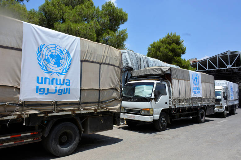UNRWA trucks being loaded at the UNRWA Syria Field Office compound ahead of a convoy to Yalda. On 5 June, UNRWA managed to access Yalda for the first time in two years. © UNRWA 2018 Photo by Iyad Faouri
