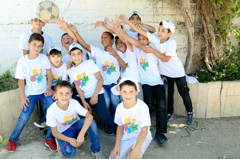 The students of Hebron Boys' School enjoy the opportunity to gather and play football with their peers during the Saturday EU Fun Days this summer. © 2018 UNRWA Photo by Iyas Abu Rahma