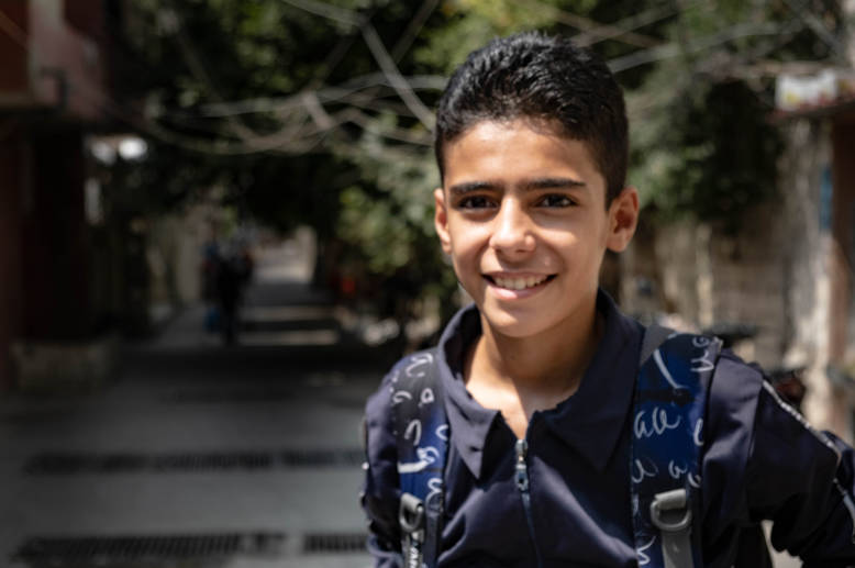 """I'm very happy that UNRWA schools opened on time this year. If they hadn't, I wouldn't have been able to register in a private school and I would be on the street,"" explains Obaida, an UNRWA student from Deir Qasi School in Saida, Lebanon. Bidding farewell to a summer spent playing football with his two brothers, Obaida carefully organises his books, pens and school supplies in preparation for the year ahead. After a healthy breakfast of fruit, cheese and a few dates, eager Obaida makes his way to school."