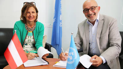Austrian Representative Astrid Wein and UNRWA Officer in Charge, External Relations and Communications Department, Arabic Language Spokesperson, Sami Mshasha, sign contribution agreements. © 2020 UNRWA photo by Marwan Baghdadi