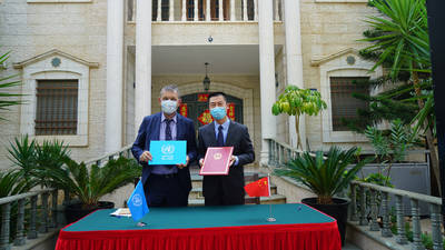UNRWA Commissioner-General Phillipe Lazzarini (left) and His Excellency, Head of the Office of the People's Republic of China to the State of Palestine, Ambassador Guo Wei sign contribution agreeement for support to Palestine refugees. © 2020 Photo by Representative Office of People's Republic of China to the State of Palestine.