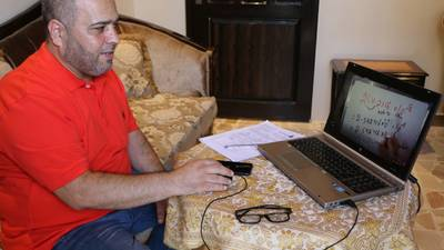LFO teacher: Mustafa Mustafa in his home during a distance learning lesson. © 2020 UNRWA photo by Maysoun Mustafa