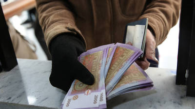 a Palestine refugee receiving some assistance at an UNRWA cash distribution centre in Syria. UNRWA cash assistance helps reduce vulnerability and increases the resilience of Palestine refugees in Syria. © 2020 UNRWA Photo