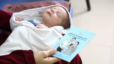 A baby at UNRWA Shaboura Health centre in Rafah Camp, Gaza receiving vaccinations.  © UNRWA Photo by Khalil Adwan