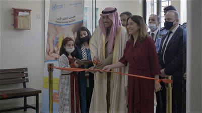 The Ambassador of the Kingdom of Saudi Arabia, His Excellency Naif bin Bandar al-Sidairi (center left),  and the Director of UNRWA Affairs in Jordan, Ms. Marta Lorenzo (center right), cut the ribbon to the newly constructed  Saudi-funded UNRWA health center in Aqaba, Jordan during the inauguration ceremony held on 31 January 2021.  © 2021 UNRWA Photo
