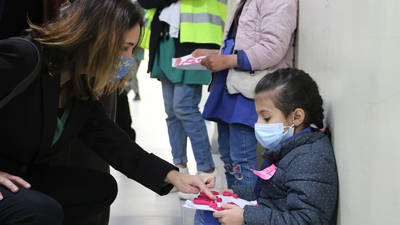 Marta Lorenzo, Director of UNRWA Affairs in Jordan (left), speaks to a young Palestine refugee  student (right)  on the first day back to learning of the second semester at the Russeifeh School  in Zarka, Jordan on 7 February 2021. © 2021 UNRWA Photo