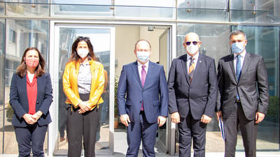 The Minister of Foreign Affairs from Romania, H.E. Mr. Bogdan AURESCU (center), accompanied by the Secretary of State of Romania  (Ministry of Interior), Dr. Raed ARAFAT (2nd from right) and the Ambassador of Romania to Jordan, H.E. Nicolae COMĂNESCU (right) are photographed with the Deputy Commissioner-General of UNRWA, Ms. Leni Stenseth (2nd from left), and the Director of UNRWA Affairs in Jordan, Ms. Marta Lorenzo (left) during a visit to UNRWA in Jordan on 4 April 2021. © 2021 UNRWA Photo