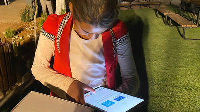 "A young Palestine refugee from the Sateh al-Bahr Bedouin community receives a tablet as part of the  EU-UNRWA ""Education for Life"" campaign. © 2021 UNRWA Photo by Dina Sharif"