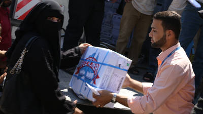 32-year old Palestine refugee Fatima Al Sabti is collecting her assistance in the UNRWA Distribution Centre in East Gaza . © 2016 UNRWA Photo by Mohamed Yaghi