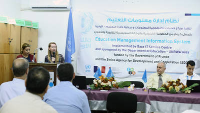 The Deputy Director of UNRWA Operations in Gaza, Ms. Melinda Young, speaks at the Education Management Information System (EMIS) launch at Al Zaitoun Preparatory Girls school in Gaza city. © 2016 UNRWA Photo by Tamer Hamam