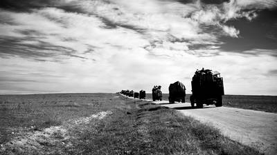 In this iconic photograph from the UNRWA Film and Photo Archive, a convoy of trucks carries refugees and their belongings from Gaza to Hebron in the West Bank. © 1949 UN Archives Photographer Unknown