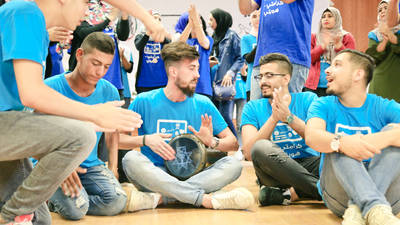 Palestine refugee youths participate in an annual UNRWA summer camp, this year organized under the theme 'My Identity Is My Signity'. The UNRWA community mental health programme organized 18 summer camps led by forty-six Palestine refugee youth camp leaders trained by the Agency's relief and social services programme.  © 2018 UNRWA Photo by Iyas Abu Rahmah