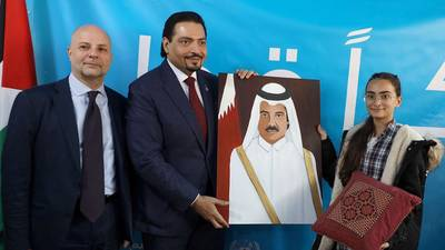 In the presence of the Director of UNRWA Affairs in Lebanon, Claudio Cordone, an UNRWA student from the Nablus Girls' School presents a gift to His Excellency Ambassador of Qatar to Lebanon, Mohammed Hassan al-Jabir.  © 201 UNRWA Photo by Ahmad Mahmoud
